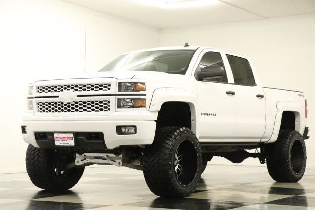 2014 Chevrolet Silverado 1500 4x4 Lifted on camaro parked
